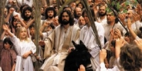 Jesus enters Jerusalem on a donkey
