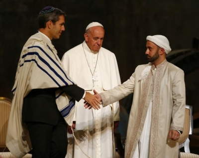 Rabbi Elliot Cosgrove and Imam Khalid Latif shake hands in front of Pope Francis during an interfaith ceremony at the 9/11 Memorial Museum.