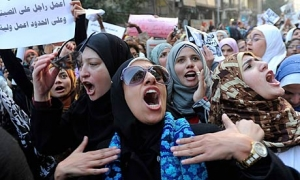 Egyptian women protest against the army's use of violence against them in Cairo in 2011 after images of women who had been brutally beaten were circulated. Photograph: Mohamed Omar/EPA