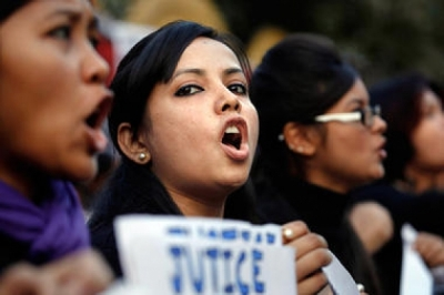 Students shout slogans during a protest against a leader of the ruling Congress party, who was arrested on accusations he raped a woman in a village in the early hours of the morning, in Gauhati, India, Thursday, Jan. 3. Recent post-rape protests have renewed debate over the rise of a new urban middle-class activism in India.