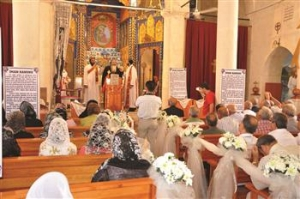 "This article in a Turkish daily newspaper, ""Christians in Middle East Call for Unity,"" offers the following caption, ""This file photo shows a Christian mass from a Syriac church in the southeastern province of Adıyaman in Turkey. DHA Photo"""