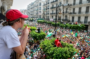"""'Go!' Protestors demand that remaining Bouteflika officials step down in Algiers this July,"" Farouk Batiche · Anadolu · Getty"