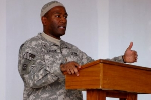 Army Chaplain (Maj.) Ibraheem Raheem delivers a sermon for Muslim soldiers during a service Aug. 29, 2008, at Camp Victory, Iraq. Raheem is one of only six Muslim chaplains in the Army, and is the only one currently deployed in Iraq. U.S. Army photo by Sgt. David Turner, Multinational Division Center