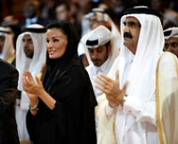 The first lady of Qatar, Sheika Mozah bint Nasser, left, and the emir of Qatar, Sheik Hamad bin Khalifa al-Thani, attended the World Innovation Summit for Education in Doha