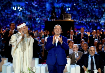 Rachid Ghannouchi, right, the leader of the Ennahda party in Tunisia, and Abdelfattah Mourou, the vice president, on Friday at the party's congress. On Monday, Mr. Ghannouchi won re-election with 800 of 1,058 ballots cast. Credit Fethi Belaid/Agence France-Presse — Getty Images