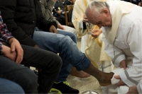 """I will wash the feet of others."" No pope had ever done this. On Holy Thursday, March 28, 2013, reflecting a ritual that Jesus washed the apostles' feet before his death, Pope Francis washed the feet of 12 criminal offenders. That included two women, one a Serbian Muslim (Osservatore Romano via AFP/Getty Images)"