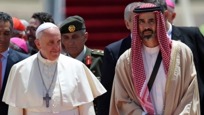 Pope Francis is welcomed by Jordan's Prince Ghazi bin Muhammad. Credit: Reuters/Muhammad Hamed
