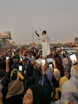 """Earlier this week, an iconic photo [taken by local photographer Lana Haroun] of a woman named Alaa Salah, a 22-year-old engineering and architecture student, addressing protesters from atop a car went viral."" From a Vox article, ""The Women who helped bring down Sudan's president."""