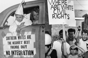 White children protest desegregation in Chicago, Illinois, 1966. (Declan Haun/Chicago History Museum) Seven-year-old dressed in Ku Klux Klansman robes rides in a Klan motorcade on August 14, 1956, in Macon, Georgia. (Bettmann/Getty Images)