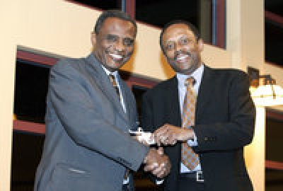 """Abdullahi Ahmed An-Na'im (left) and Provost Earl Lewis."" Here, An-Na'im receives the 2006 Marion V. Creekmore Award for his internationalization of human rights at the Emory University Center for the Study of Law and Religion."