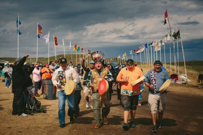 Members of the Anishinabek Nation sing as they enter the Standing Rock Sioux tribe's protest encampment. Photograph by Alyssa Schukar / The New York Times