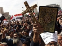 """Tens of thousands of Egyptians swarmed the Tahrir Square in down town Cairo on Friday (March 14, 2011), in a march aimed at solidifying national unity between Muslims and Christians in Egypt."" May it happen once again!!"