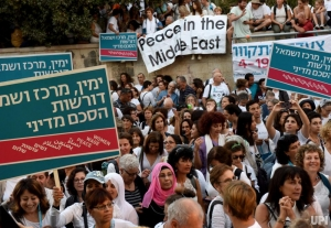 "In an article by The Thirdside, ""March of Hope: How Israeli-Palestinian Women Wage Peace."" Photo caption: ""Israeli, Druse and Israeli Arab women of 'Women Wage Peace' protest outside Israeli Prime Minister Benjamin Netanyahu's resident in Jerusalem, Israel, October 19, 2016. The women's march is to urge lawmakers to act to bring a secure future for their children by making peace."" Source: Debbie Hill/UPI"